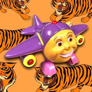 """2002 Tracy 3"""" Toy Island Plastic Airplane Toy"""